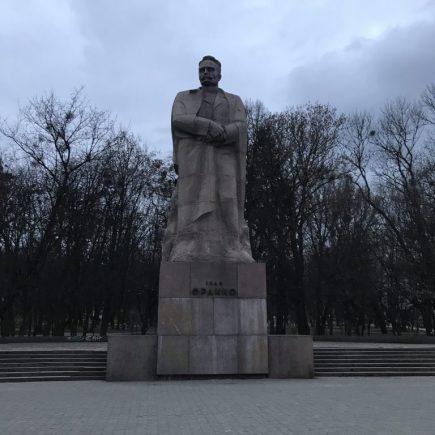 statue of an older man in a park in L'viv, Ukraine