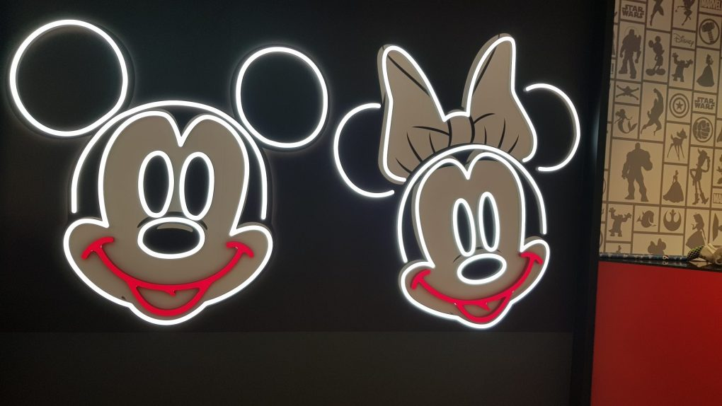 Neon Mickey and Minnie mouse signs in the Primark Disney Cafe