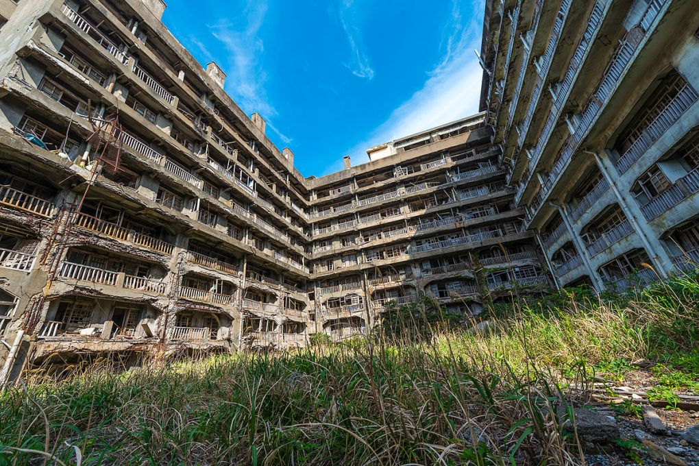 Abandoned buildings surrounded by grass