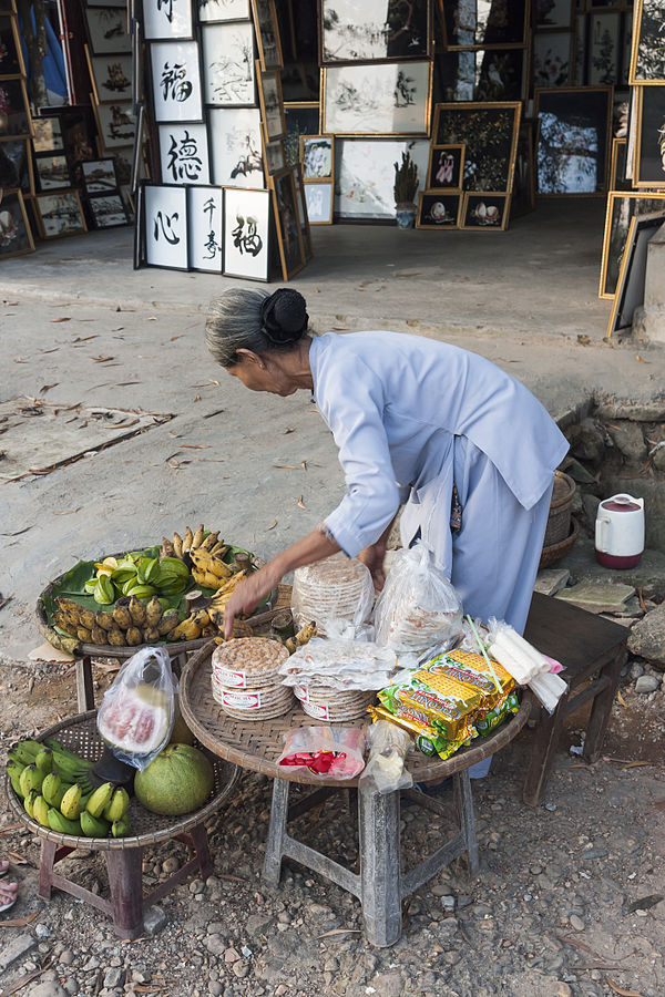 Countries in need: A Vietnamese woman setting up a food stall