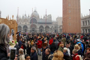 St. Mark's Square was full of tourists and people in costume - Venice, Italy