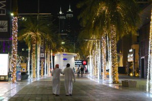 We strolled behind these men along a main Dubai street as we admired the lights and beauty of the city - Dubai, UAE