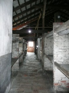 Bunk beds in the barracks were stacked three high and many prisoners were crammed onto each bed - Auschwitz, Poland