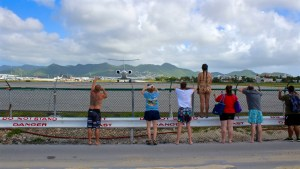 Oh hey there I am on top of the fence - Maho Beach, St. Maarten