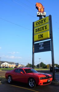 Cozy Drive In sign with a corvette