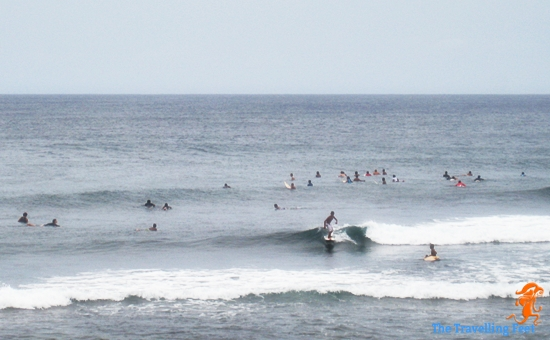 surfers surfing in Siargao Philippines