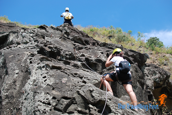 Filipina explorer climbing rocks
