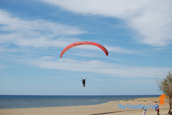 paragliding landing by the beach