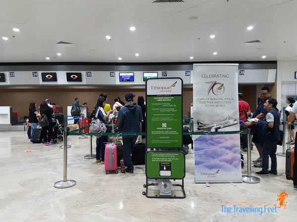 lining up to check in with ethiopian airline