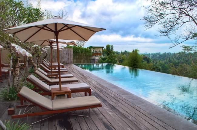 Infinity pool overlooking the jungle at Bisma Eight, Ubud, Bali, Indonesia