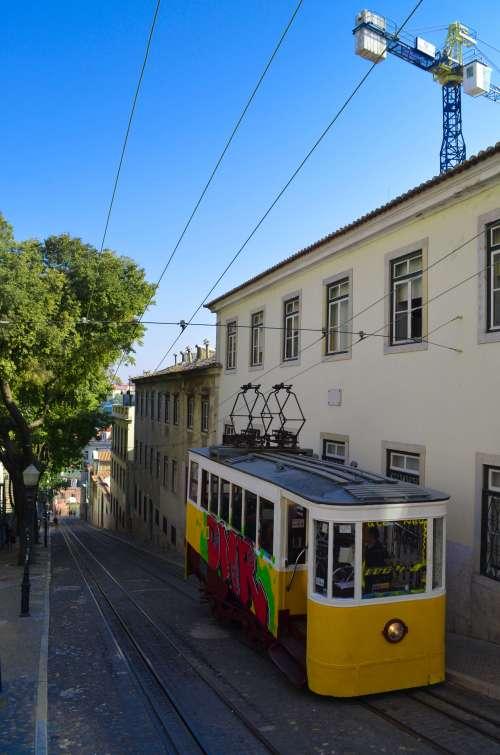 Yellow historic tram in Lisbon, Portugal