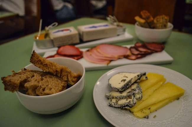 Charcuterie and cheese platter on The Presidential gourmet food train, Porto, Portugal