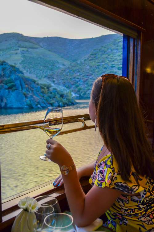 Wine and views of the Douro valley onboard The Presidential gourmet food train, Porto, Portugal