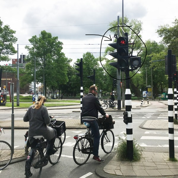 People stopped at a red light in the bike lane | Biking in the Netherlands | Utrecht | The Travel Medley