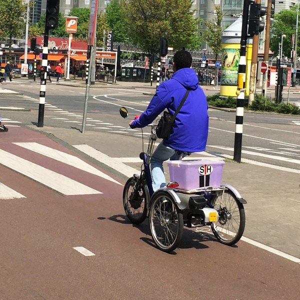 Guy on a three wheeled bike | Biking in the Netherlands | Utrecht | The Travel Medley