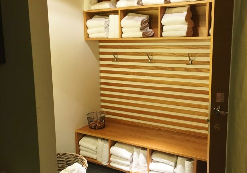 Shelves of towels and a bench in the changing area.