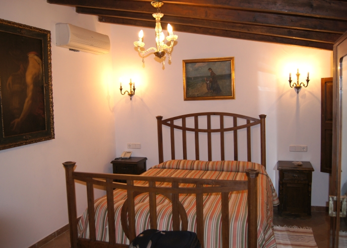 A guest bedroom at the Dalt Murada, a historic city centre hotel in Palma, Mallorca, Spain