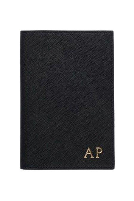 The Daily Edited Passport Holder
