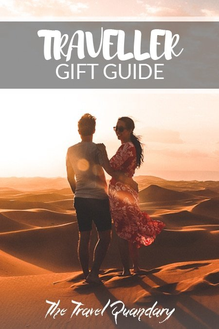 Pin to Pinterest: A couple enjoying the sunset over the dunes of the Sahara Desert, Morocco | Gift ideas fortravellers