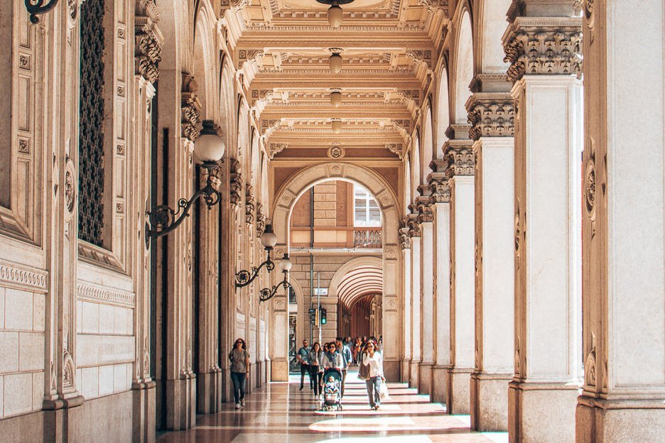 Walking under the intricate archway porticoes of Bologna Italy - best hidden gems in Europe