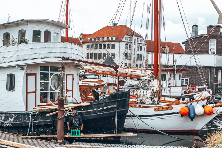 Boats moored in Nyhavn - Copenhagen City Guide, Denmark