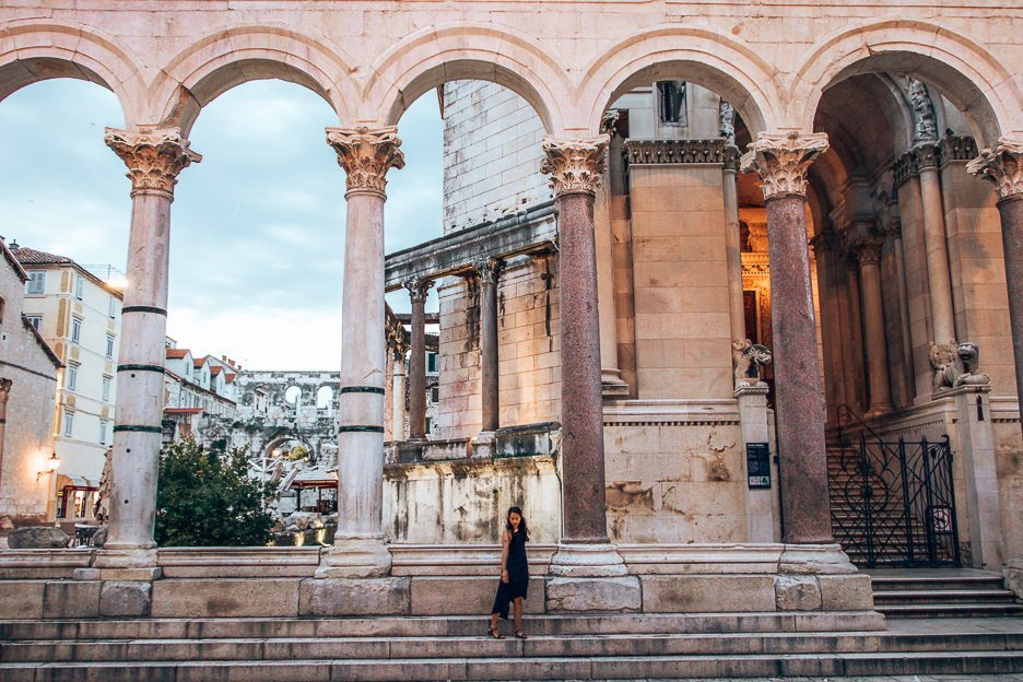 Under the arches of Trg Peristil within Diocletian's Palace at sunrise, Split Croatia