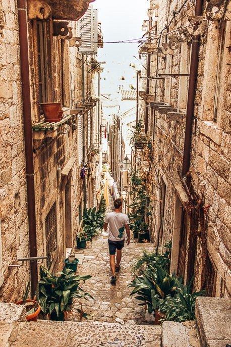 Bevan walks down steep stairs of Dubrovnik Old Town, Croatia