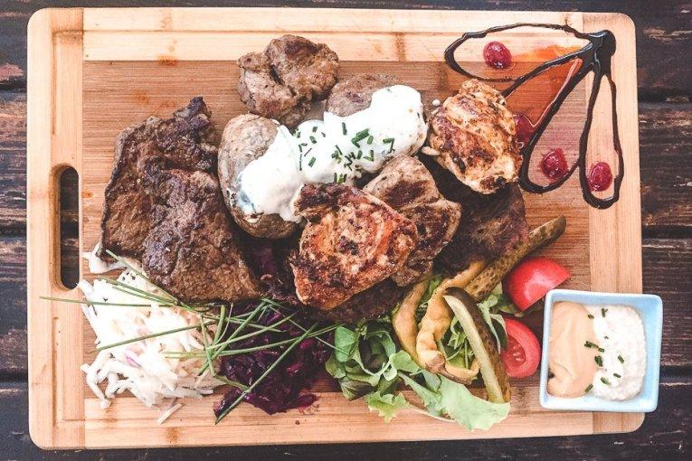 A meat platter with potatoes, salads and dips at Krčma v Šatlavské ulici, Cesky Krumlov