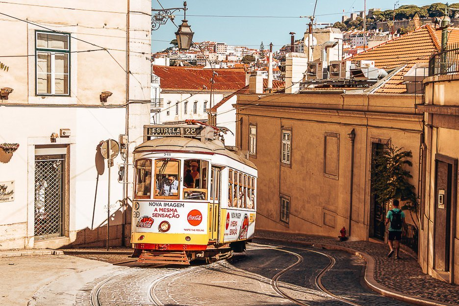 Yellow tram 28 rumbling up the hill - Lisbon, Portugal
