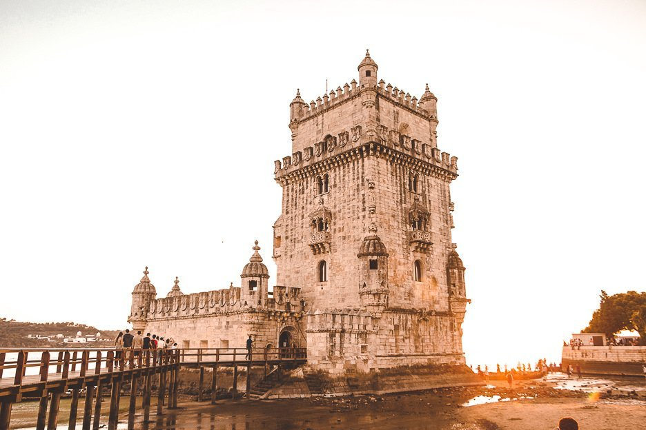 Sunset and low tide at Belem Tower - Belem, Portugal
