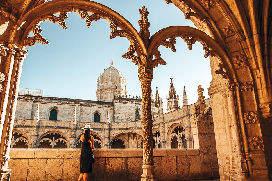Jasmine stands on one of the balconies under intricate arches of Jeronimos Monastery - Belem, Portugal