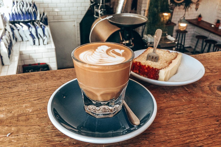 A latte and slice of cake at Lot Sixty One