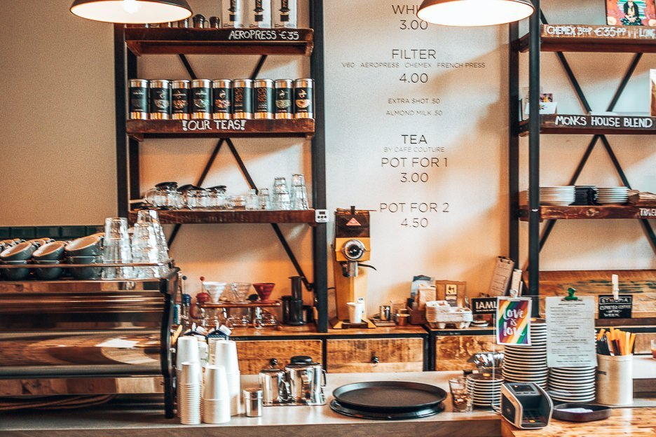 Coffee counter and shelves at Monks Coffee Roasters