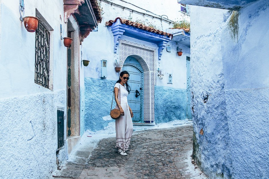 How many days in Chefchaouen | Woman dressed in white stands in a blue laneway in Chefchaouen Morocco