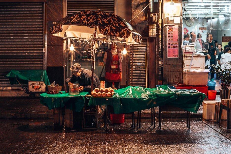 An elderly man packing up his market stall - Mong Kok, Hong Kong