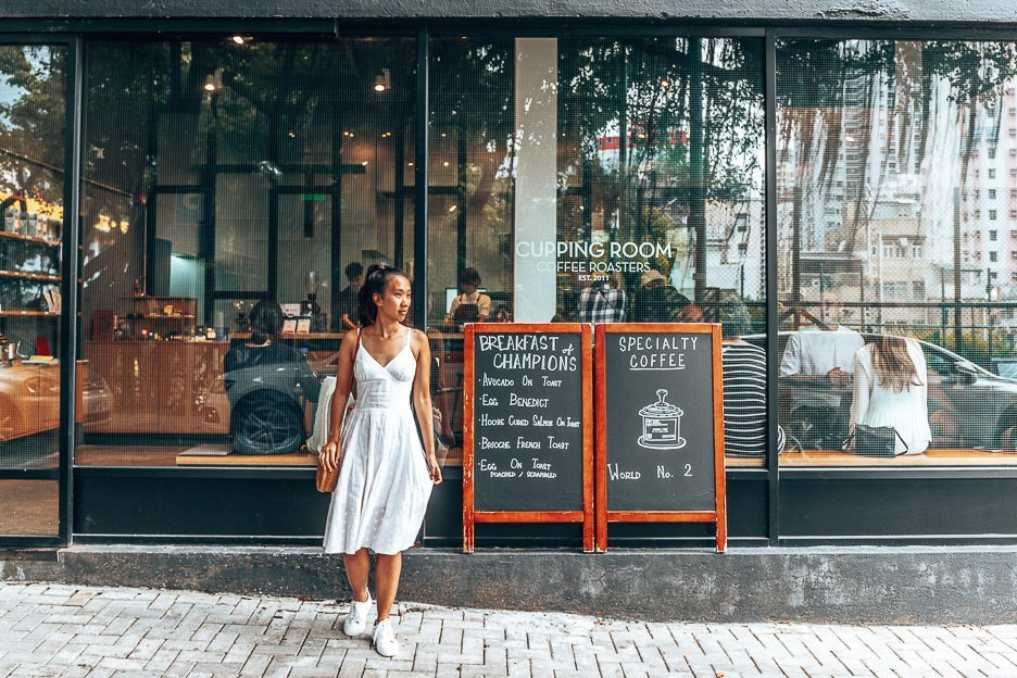 Jasmine standing outside The Cupping Room, one of Hong Kong's best cafes for coffee!