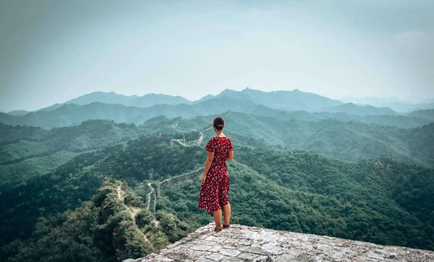 Picture of girl looking out at the Gubeikou section of the Great Wall of China