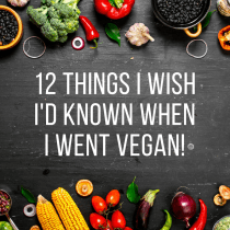 Overhead image of vegetables with text saying twelve things I wish I'd known when I went vegan