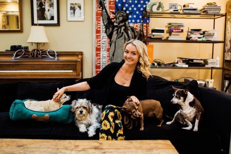 header photo of Jessica Hoar, aka The Tree Kisser, on a couch with four rescue dogs