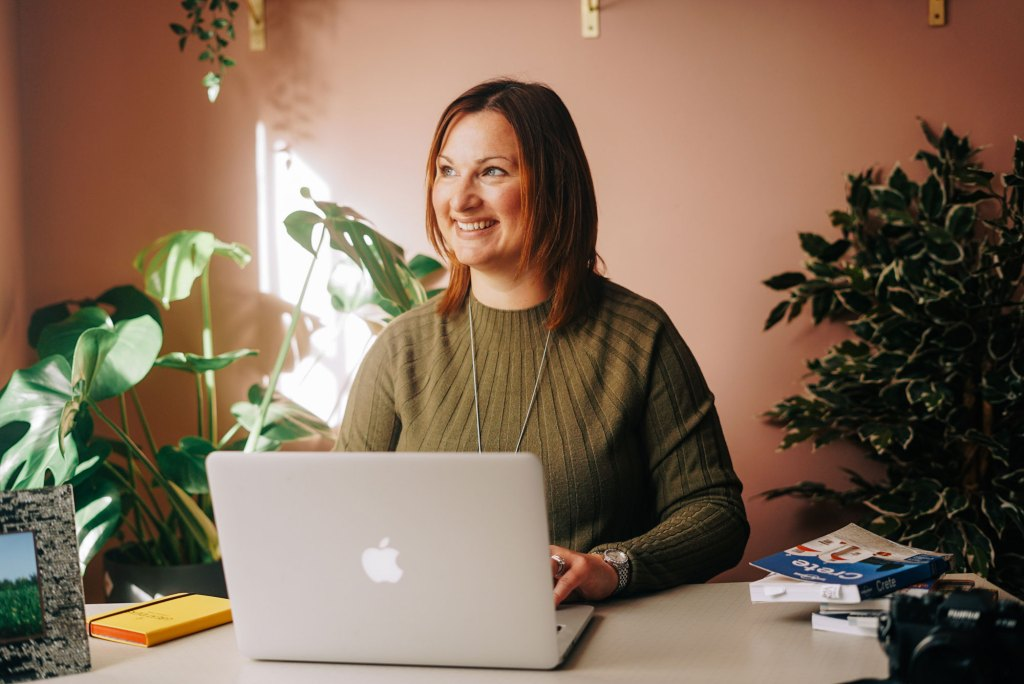 Claire Hall, award-winning blogger and digital content professional sat at a desk