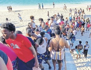 WITH fears growing that we could be on the brink of a third wave of COVID infections this was the scene at Cabbage Beach on Paradise Island on Sunday evening.Hundreds of youngsters had packed the eastern end of the beach all day. Few, if any, wore a mask and social distancing guidelines were blatantly ignored. For over a year we have been warned to stick to the rules - avoid super spreader events and we can beat this pandemic. Now, with Easter just days away all pretence of playing safe seems to have been abandoned. Photo: Racardo Thomas