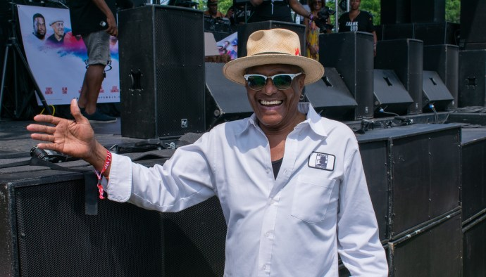 Chicago music legend George Daniels catching Motown diva Thelma Houston's set