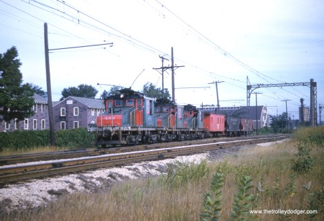 Electric loco 453 heads up a short freight train.