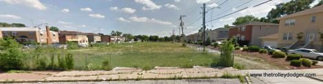 Looking south at the old Westchester right-of-way from Van Buren in 2011. The tracks followed the alignment of the telephone poles. This area has been built up since then.