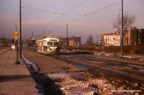 Prewar PCC 4029 is shown heading south on a section of Cottage Grove between 33rd and 35th that had already been sold by the city to developers and was already off-limits to car and truck traffic. CTA was given six-month extensions on streetcar service through this area before the route was bussed in June 1955.