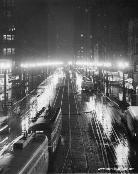 """It's February 22, 1950, looking south on State Street. """"Chicago's famed State Street gleams with all its brilliance before half of the lights were turned off to save fuel as the Coal strike cuts Illinois's output of coal 95 per cent. The State Street Lighting association began a 50 per cent voluntary dim-out of the street to save meager fuel supplies. The PCC is on route 36 - Broadway-State, while the Peter Witt is on route 4 - Cottage Grove."""