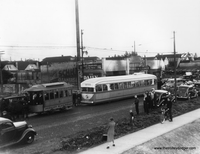 """It's August 28, 1936 on north Ashland Avenue, and time for a parade. One week earlier, streetcar service had been extended north of Cortland in one of the final extensions under CSL. Prior to this time, this portion of the route had run on Southport, two blocks to the east. North Chicago Street Railroad """"Bombay roof"""" horsecar 8 is ahead of the experimental 1934 Brill pre-PCC car 7001. Ironically, the older car survives at the Illinois Railway Museum, while 7001 was scrapped in 1959. On the other hand, Mike Franklin writes: """"Dave, the top photo is taken at 8537 S. Commercial, Chicago. Schmidt Cleaning and Dying. It is not Ashland Ave. Do Google Earth and it all makes sense."""" If you are correct, then this picture was probably misidentified, and the parade actually took place around May 2, 1937, when the east and west portions of the 87th Street route were connected via a through route. Thanks for your detective work."""
