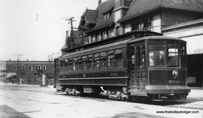 """Roy Benedict writes, """"Chicago City Railway car 5232 is on 51st St. at Grand Blvd. (now King Dr.) as evidenced by the distant building, which appears in later photos. The car tracks ended at the boulevard then and for a couple of decades later."""" This photo must predate 1914, when the Chicago Surface Lines came into being. According to Don's Rail Photos, """"1st 5201 thru 5250 were built by Brill-American Car Co in 1906, (Order) #15365, for CCRy as 5201 thru 5250, but it was shipped to United Railroads of San Francisco due to the earthquake. 2nd 5201 thru 5250 were built by Brill-American Car Co in 1906, (Order) #15365, to replace the orignal order. They were rebuilt in 1909 to bring them up to the standard of the later cars."""""""