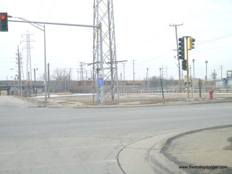 Looking west from Madison and 25th. Some of the same high tension lines are visible in image 196 in our previous post.