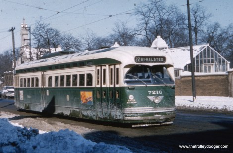 """CTA 7216 on route 22 - Clark-Wentworth. Andre Kristopans says, """"PCC 7216 SB just south of Irving Park. Wunder's Cemetery in background."""""""